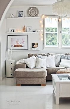 Floating shelves, fairy lights and L shape sofa