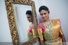 South Indian bride. Gold Indian bridal jewelry.Temple jewelry. Jhumkis. silk kanchipuram sari with contrast green blouse..Braid with fresh flowers. Tamil bride. Telugu bride. Kannada bride. Hindu bride. Malayalee bride.Kerala bride.South Indian wedding.