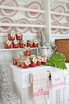 Red & white transferware dishes, dish towel and coffee pots, and strawberry preserves on a white cabinet -- kitchen vignette -- VIBEKE DESIGN