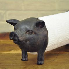 "Well, who doesn't want a rustic pig to hold your paper towels in the kitchen?? Especially a piggie as cute as this one is, right down to his curly tail! When we showed this around the office and warehouse everyone loved it! What a great way to make boring paper towels fun and decorative! Measures approximatey 6.25""H x 6.25""W x 18.5"" long, when holding a standard paper towel roll. #farmhouse #kitchen"