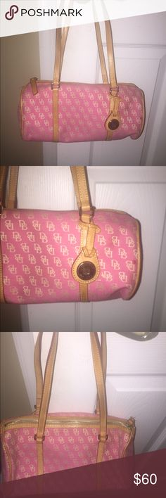 Dooney & Bourke pink bag This cute small bag is in good condition. A red stain pen mark on the front could be seen on picture. Leather straps make this cute bag adorable. Dooney & Bourke Bags