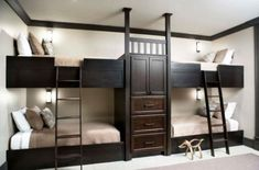 Solid oak bunk beds with central storage. Bunk Beds For Four, A Space-Saving Solution For Shared Bedrooms Black Bunk Beds, Bunk Beds Built In, Kids Bunk Beds, Loft Beds, Trundle Beds, Sleepover Room, Casas Containers, Bunk Rooms, Bunk Bed Designs
