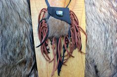 Lovely Small version of our Signature Medicine Bags, made of Black Goatskin leather, and soft Muskrat Fur, Fringed Tassels and Necklace Strap are made of Deerskin Leather Lace. Beaded Gemstone Tassels