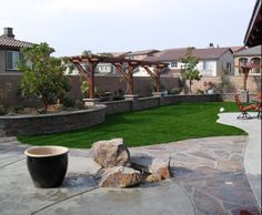 Complete Backyard Renovaton With Flagstone Patio, Rasied Planter With  Arbor, And Lawn