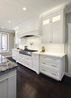 WHITE KITCHEN || Custom white painted cabinetry with custom hood and marble top