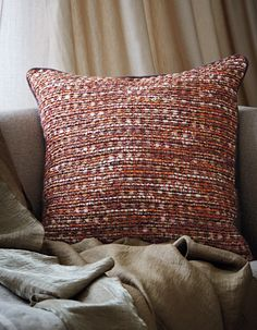 Cushion: Persia - Pomegranate, Curtain: Cleopatra - Gold, Sheer: Weathered Web - Camel, Sofa upholstered in Barbarian - Flax, Opera pieces in Topaz draped on the sofa. Linen Bedding, Bed Linen, Upholstered Sofa, Drapery Fabric, Luxury Interior, Soft Furnishings, Innovation Design, Cushions, Throw Pillows