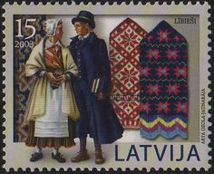 Latvian postage stamp depicting mittens and costumes of Livonian people in Latvia