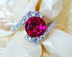 As Seen in Vogue! Ruby Ring or Engagement Ring Handmade by NorthCoastCottage Jewelry     https://www.etsy.com/listing/173157583/as-seen-in-vogue-ruby-ring-engagement?ref=related-4#