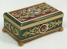 An exquisite and stunning Faberge hinged box constructed of translucent nephrite jade with spinach mottling with 14k yellow gold frame, feet and appliques. Jeweled throughout with floral, crown and monogram designs over opalescent and red guilloche enamel. Set with diamonds and cabochon ruby jewels. Workmaster Dmitriì Aleksandrov Pastukhov.