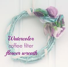 Add some color to your entryway with this DIY Watercolor Coffee Filter Flower Wreath