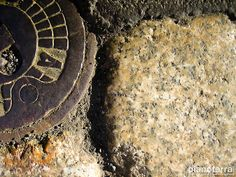 Manhole, stone and asphalt. Milano.