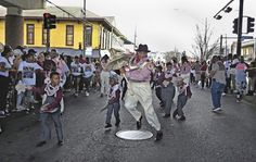 The Second Line, photos by Charles Muir Lovell; traditions of New Orleans's African American community seen in second line parades organized by social aid and pleasure clubs.