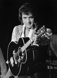 """JULY 14, 1975  -   ELVIS PRESLEY on stage at the SPRINGFIELD, Massachusetts CIVIC CENTER JULY 14, 1975. """"He was in fine voice, belting out early hits such as """"Hound Dog"""" and """"Don't Be Cruel,"""" as well as his later favorites like """"Burning Love"""" and """"Funny How Time Slips Away.""""/ Republican PHOTO BY Mark M. Murray"""