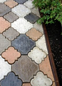 DIY Cast Concrete Patio Stones - a lot of work, but comes out to about $1.5 each, with about $200 in start up costs (for milling and cheap concrete mixer)