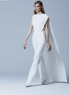 SWOONING over this jumpsuit! There is a bride out there that would LOVE this look for the big day. The avant-garde bride for sure!