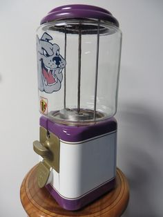 Side view of the Purple and Gold Bulldog Acorn Gumball Machine