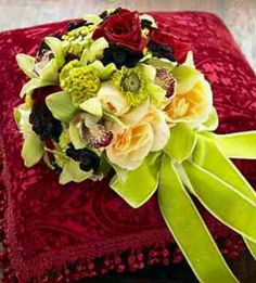 Green and yellow with a pop of red. Perfect for a fall wedding.