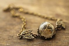 Carry your wishes with you everyday by wearing this sweet little real dandelion seed bracelet, the latest addition to my Make a wish