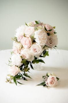 A blush tear drop bouquet of peonies and roses. Pretty and elegant. Captured by bobtale photography
