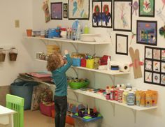 A fantastic basement make-over that becomes an child's Art Studio dream. Visit all the slides and read about the fun activity spaces they created!