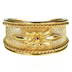 Damaskos Anthemion Flower Band Ring, 18k Gold. http://www.athenas-treasures.com/products/Damaskos-Anthemion-Flower-Band-Ring.html.  This and more handmade Greek jewelry at Athena's Treasures: www.athenas-treasures.com