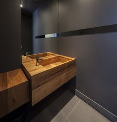Bathroom sink. How about an all timber prep table with timber sink in the kitchen? I think it would pop.
