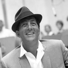 Dean Martin -  Picture it.. . .  We're sitting in a little restaurant enjoying a wonderful meal and he can't help but sing, one lovely song after another.   (sigh...)