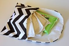 I made a this diaper clutch for a baby shower recently, to go along with the applique onesies. It's so perfect for diapers and wipes…but it's also a great size for anything! I think it's the perfect date night clutch. fabric:You don't have to make this with chevron fabric, but it's pretty cute in chevron, …
