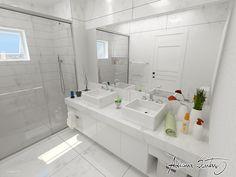 Iluminação em banheiro branco