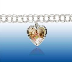 Keep that memory forever with Photoart  Charms. Hundreds of charms to choose from. Call AJ Klein Jewelers 203-929-3300 #charms #gold #bracelet#locket