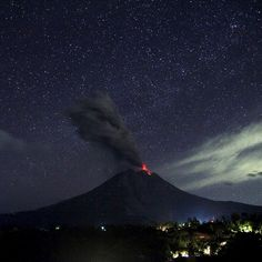 """""""Mount #Sinabung #volcano spews lava and ash during an eruption seen from Tiga Pancur village in North #Sumatra, Indonesia. Photo: Antara Foto/Reuters"""""""
