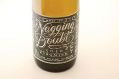 Chalk board style typography on wine labels