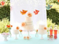 Google Image Result for http://cache.elizabethannedesigns.com/blog/wp-content/uploads/2011/03/Orange-Aqua-Wedding-Dessert-Table-600x450.jpg