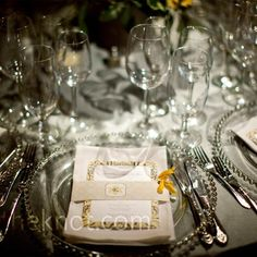 The centerpieces were mostly yellow and white, so Kristyn brought in the gray color with charcoal linens and silver-beaded chargers.