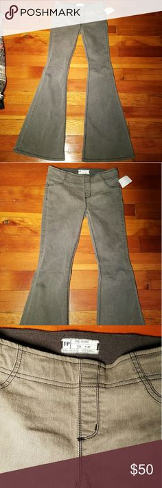 NWT Free People Kick Flare stretchy pant NWT Free People Kick Flare stretchy pull on pant. 2 back pockets. Elastic waist.  Color name: Black Sand. It's like a grey brown olive green. Free People Pants Boot Cut & Flare