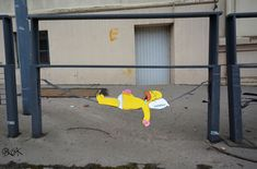Street artist OakOak pays tribute to the passing of Simpsons' co-creator with this amusing piece.