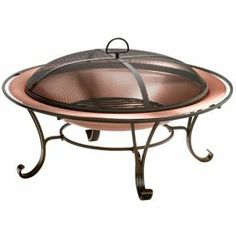 Round_copper_fireplace_with_lid