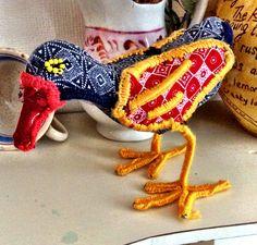Bird made of Shweshwe fabric made in The Karoo.