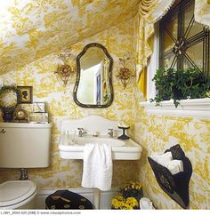 Dramatic powder room tucked under the staircase