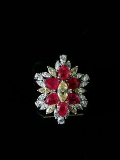 An effortlessly #graceful and #stunning #DiosabyDarshanDave cocktail #ring incorporating marquise and pear-shaped #SwarovskiZirconia in red, white and yellow tones. Handcrafted in #SterlingSilver, each stone has been skilfully positioned ensuring it glows with fire and brilliance. Ideal for a night out and #destinationweddings! Available at #JewelleryArabiaShow, Bahrain from 24th to 28th November at #boothC14 in Palm Hall