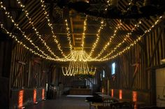 Gathered fairy light canopy in the barn at Lillibrooke Manor