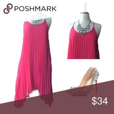 Asymmetrical Pleated Pink dress Asymmetrical Pleated Pink dress, Size M Bust 18inches and 36inches long from shoulder down to shortest part. 100% Polyester Glam Doll Dresses Asymmetrical