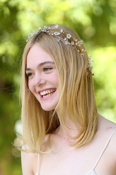 Elle Fanning wears a Twigs & Honey crystal beaded flower crown attends 'The Neon Demon' Photocall on June 6, 2016 in Rome, Italy.