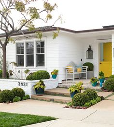 "Use greenery to take a bright white exterior from sterile to inviting. Line a walkway with colorful containers and shapely hedges for a charming look that says, ""Come on in."" http://www.bhg.com/home-improvement/exteriors/curb-appeal/creative-curb-appeal-ideas/?socsrc=bhgpin041715greencurbappeal&page=9"