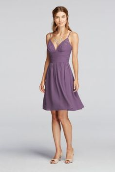 Welcome this short and sassy dress into your wardrobe!  Spaghetti straps and a deep v neckline create a fun and flirty look.  A ruched bodice combined with a flowing skirt will compliment your figure.  Fully lined. Back zip. Imported polyester. Dry clean only.  Also available in Extra Length sizes as Style 2XLF19209.  To protect your dress, try our Non Woven Garment Bag.
