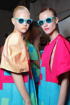 Neon color block, love the turquoise sunglasses