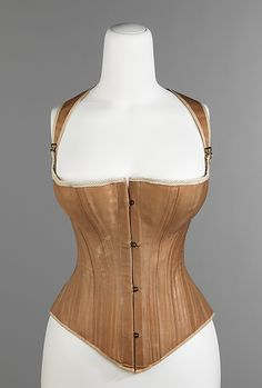 Corset Manufacturer: Madam Griswold's Date: 1876 Culture: American Medium: cotton, metal, bone Accession Number: 2009.300.3107a–c