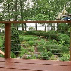 This outdoor living area has 4 levels with a cable rail railing to maximize this waterfront property. Upper ground level has a built in bench with planter box while the lower ground level deck has a beautiful Japanese style water feature.