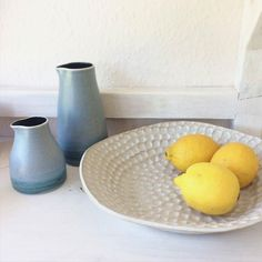 A dimpled fruit bowl happily sitting next to some beautiful pourers by Emily Myers. #ceramics #pottery #handmade #clay