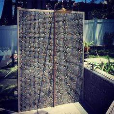 If you are living one of the Gold Coast seaside suburbs like Mermaid Beach or Miami, an outdoor pool shower is a great addition to your Gold Coast Garden Design. The outdoor pictured features matching pool tiling, copper pipe and brass shower head. Outdoor pool showers are very practical...